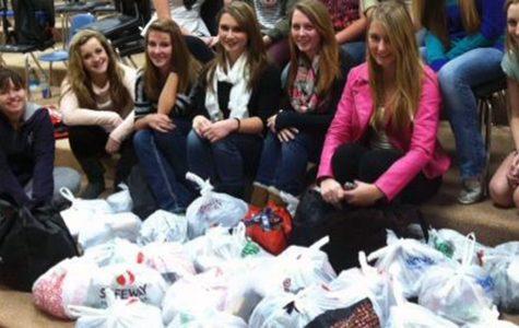 Bella Voce assembles bags for homeless