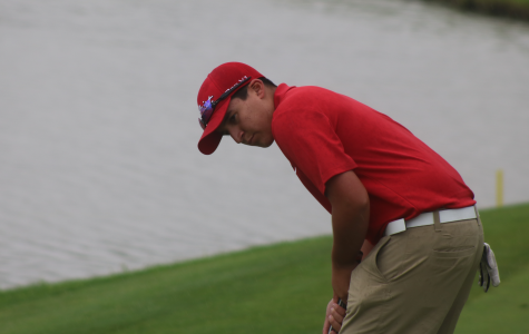 Sophomore, Grossenbacher driving golf club