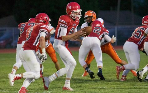 Reds plow past Lamar to start football season