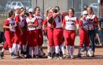 Reds softball team celebrates after winning the regional championship on 10/15/16