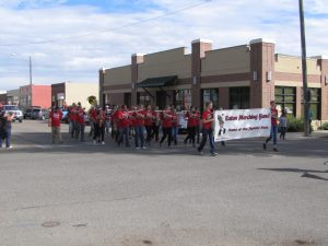 Eaton Marching Band marches their way through the streets playing their instruments for the crowds entertainment.