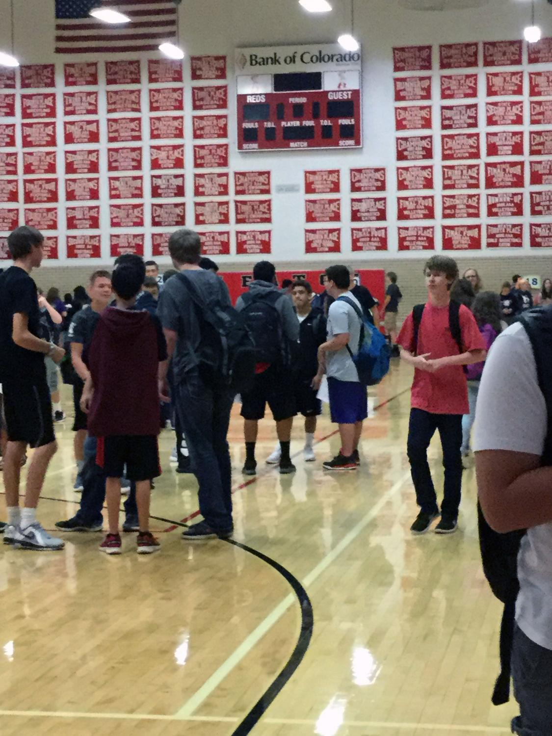 Students mill around the main gym after signing up for ICAP Day field trips.