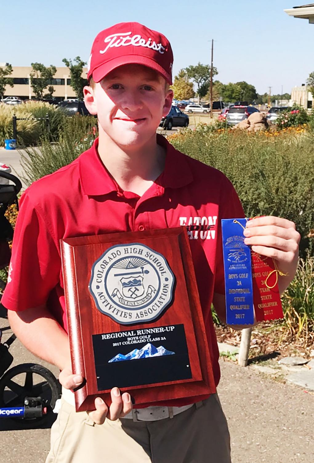 Peter Grossenbacher displays his first place plaque and ribbon at regionals. Grossenbacher won the tie breaker in a one hole shootout.