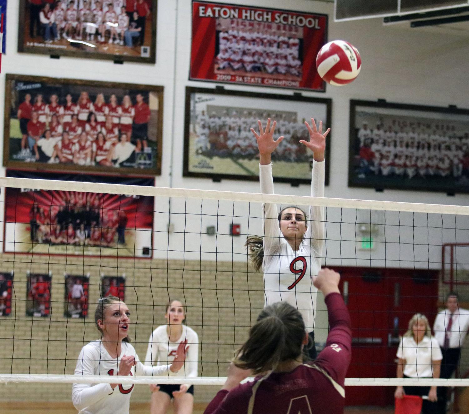 Alexis Lamoreaux (18) goes up for a solo block on an outside attack.