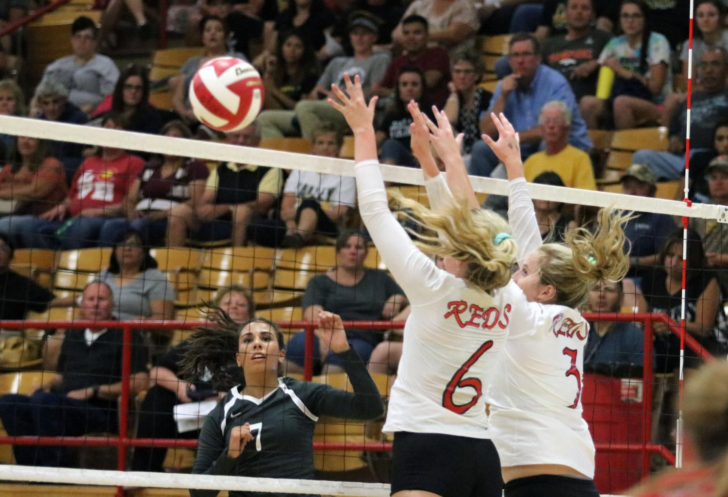 Kennedi Ingram and Darcie Kaiser go up to block an outside attack.