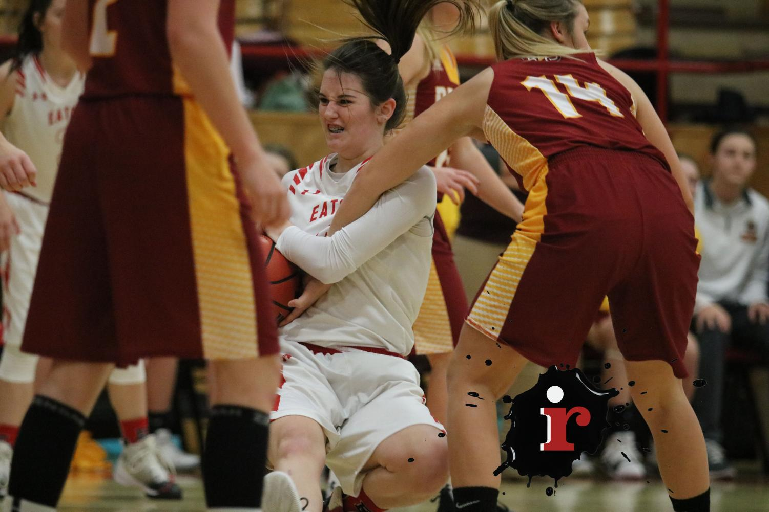 Whitley Ervin (18) scrambles for the jump ball on defense.