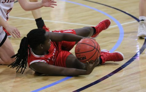 Reds capitalize win over Resurrection Christian in double overtime