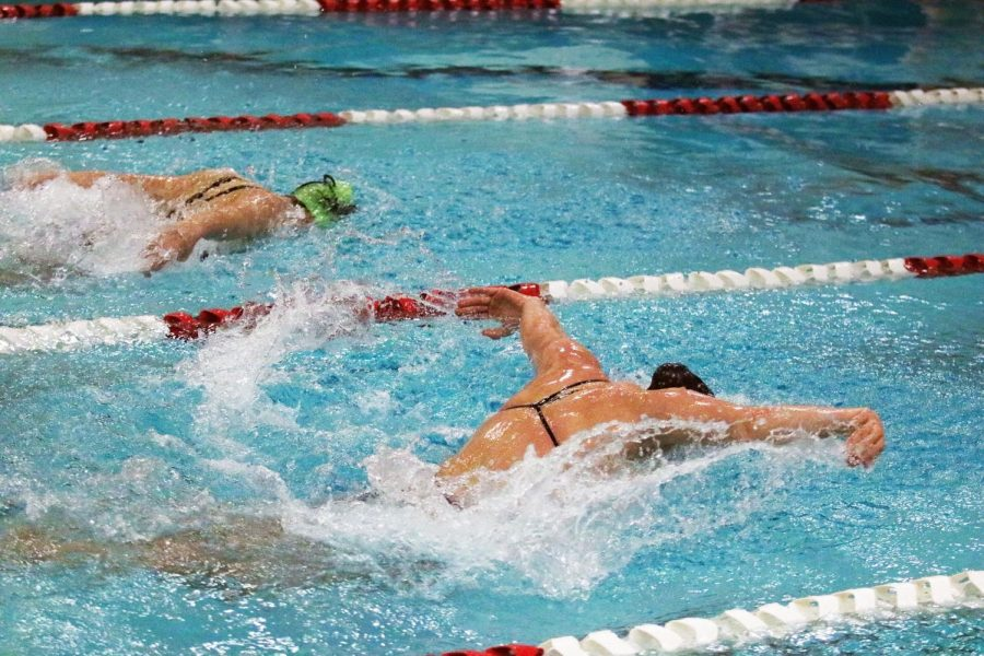 Rylee+Daniels+pulls+ahead+of+her+competitor+in+the+100+yard+butterfly+