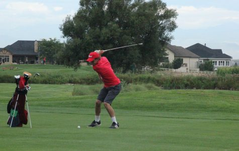 J.D. Truax (14) practices his swing before the competition.