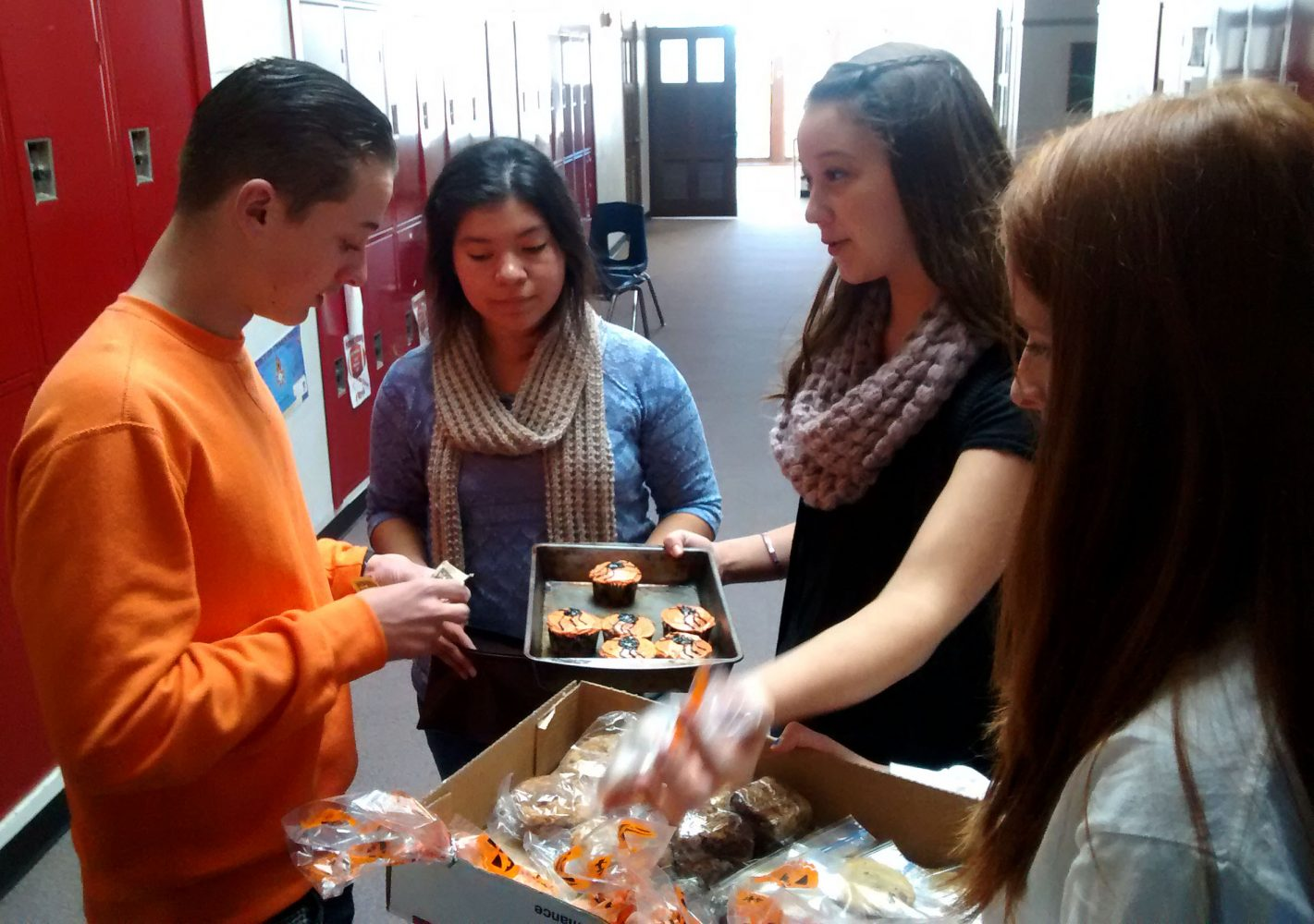 Sam Martin (15) and Abby Nelson sell treats for UNICFF