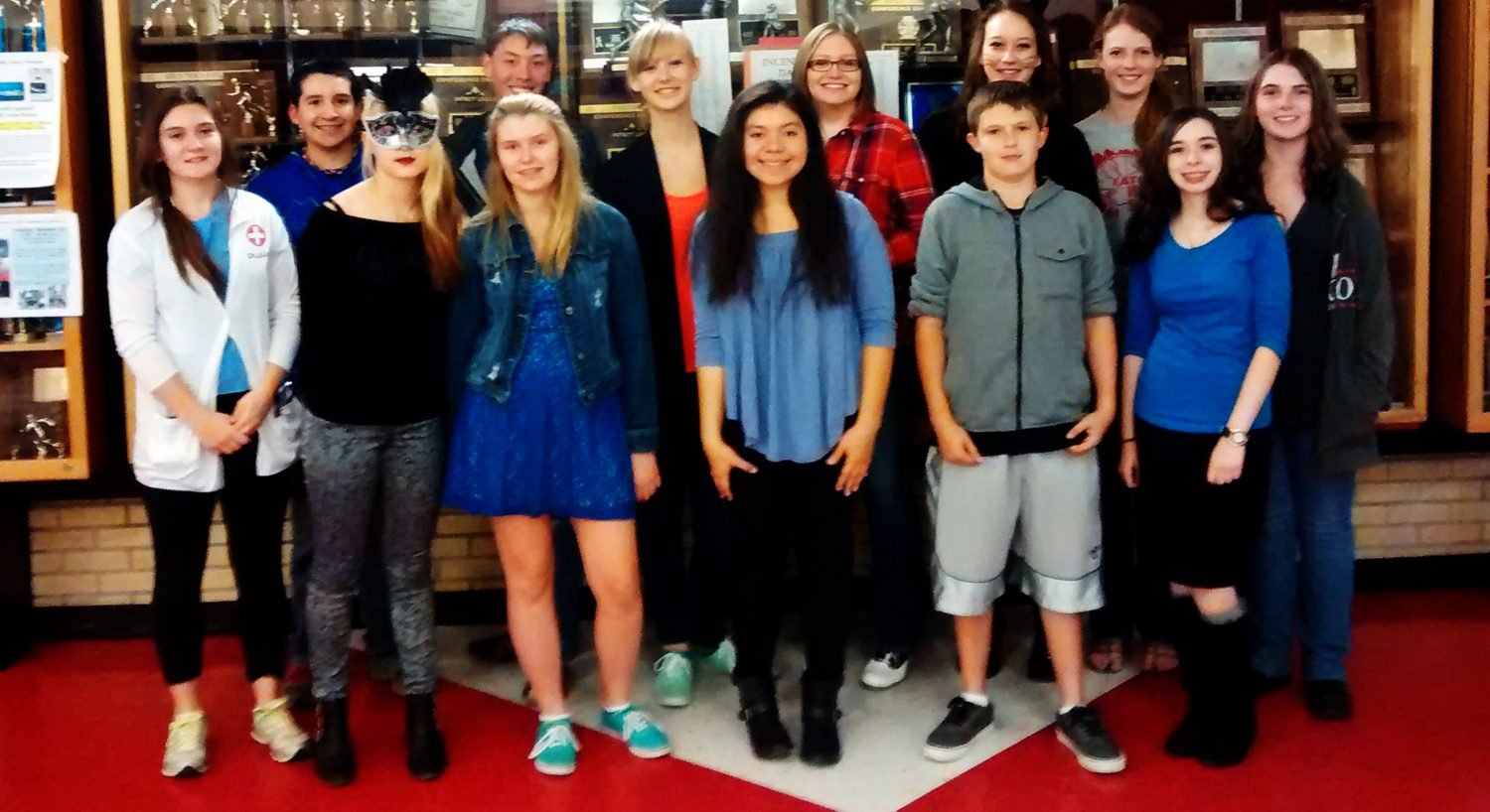 Members of Key Club take a group shot after raising over $200 for the Eliminate Project.