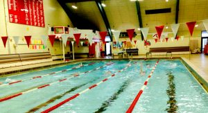 The swim team practices in the water during preseason.
