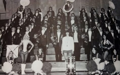 The 1974 band members pose for a photo in the high school gym.