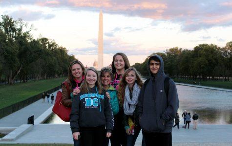 Mrs. Kirby, Hannah Olson (17), Mrs. Jones, Jehna Powell (15), Karalee Kothe (16), and Isaiah Cordova (17) in front of the Washington Monument.