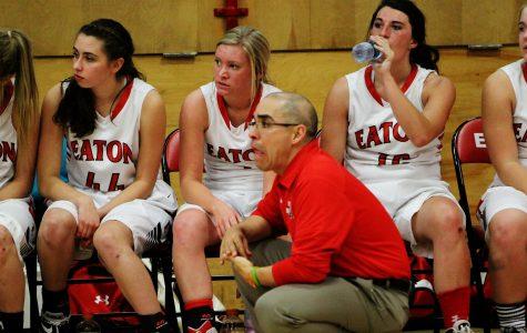 While watching her teammates play, Brynn Millett (17) listens to Varsity Coach Todd Hernandez.