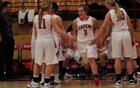 Bailey Jones high fives her teammates as a starter in the game.