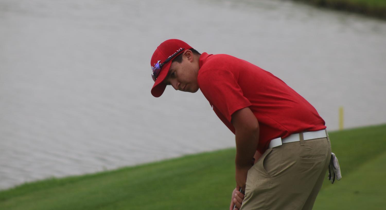 Sophomore, Grossenbacher driving golf club