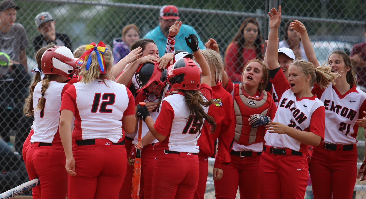 Reds Softball hits it off with explosive home opener