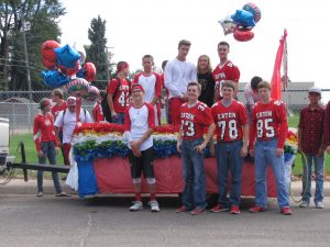 The Freshmen class prepares to play ring toss on their carnival themed float.