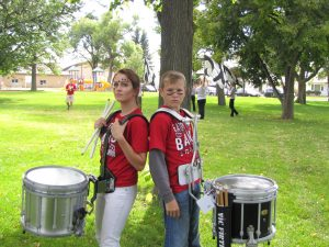 Drum players, Shelby Dyer (19) and Toby Gavette (19), pose for an image before their performance in the parade.