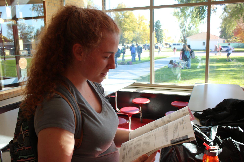 Cheyenne Moyer (18) studies the Colorado Ballot Information Booklet.