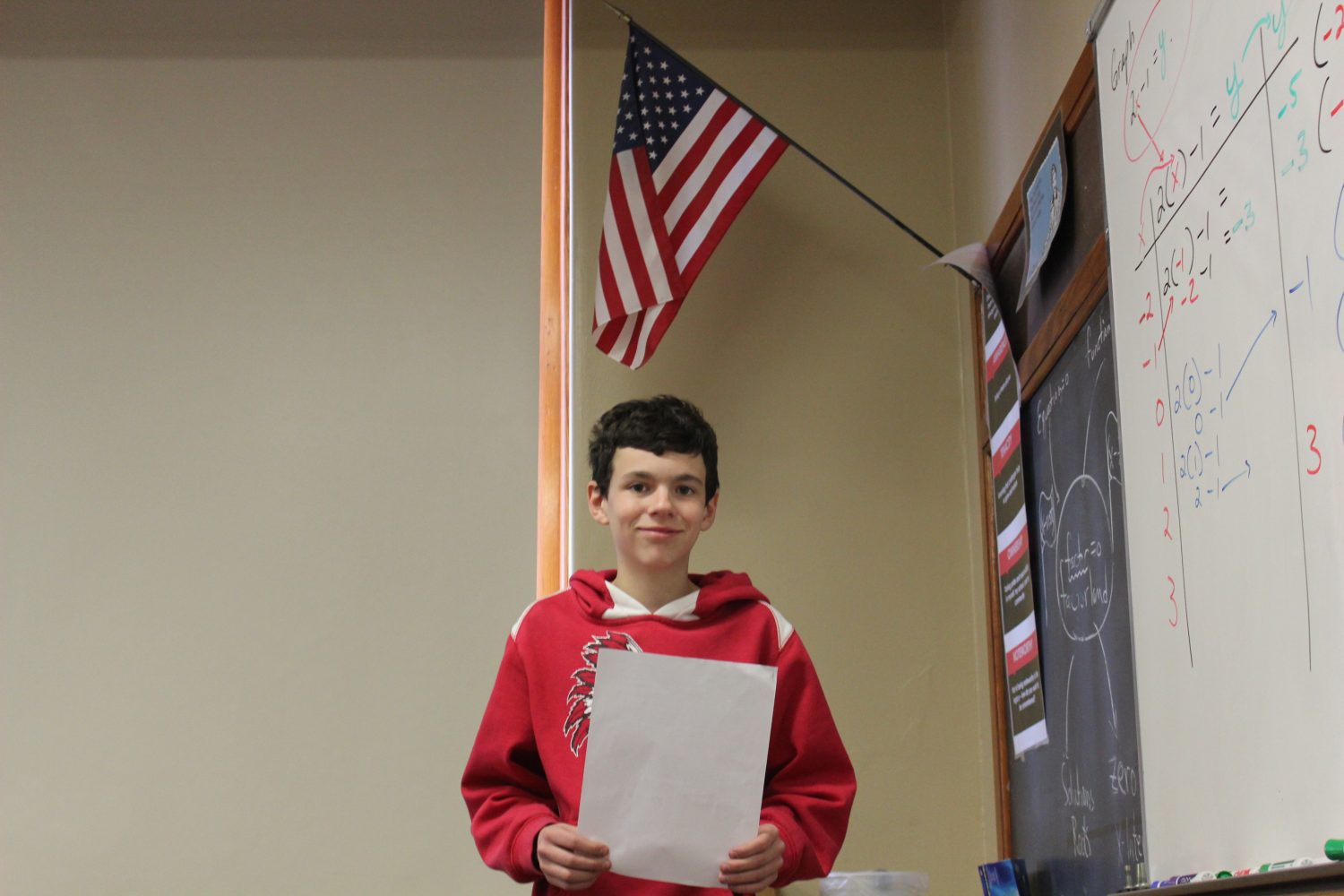 Gavin Huckaby leads Eaton High School in saying the Pledge of Allegiance