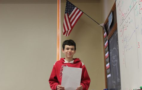 Gavin Huckaby leads Eaton High School in saying the Pledge of Allegiance