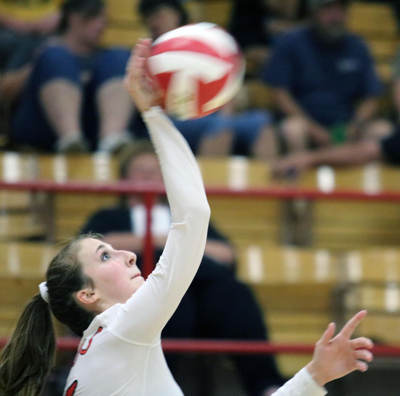 Makenzie Harris serves a ball.