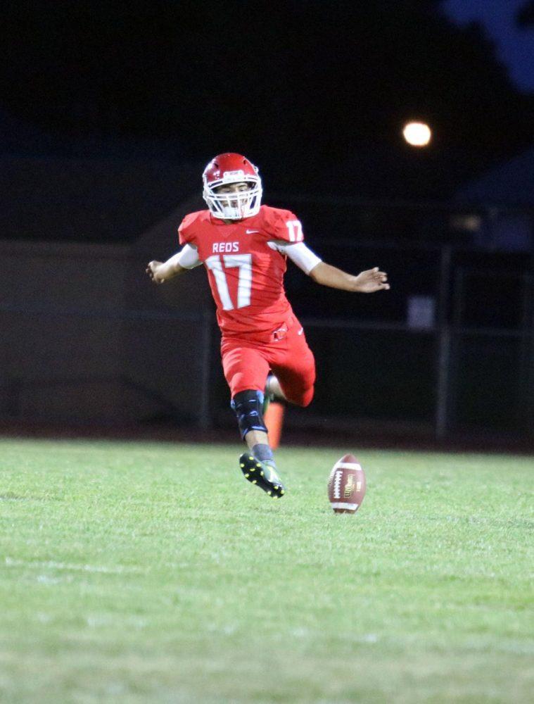 Kicker Pedro Duarte prepares to punt after an Eaton touchdown.