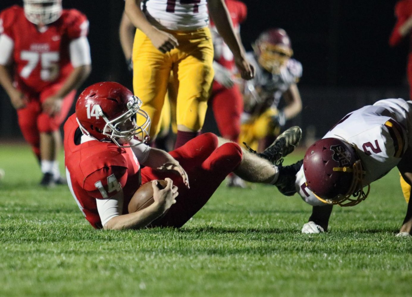 Mason Koehn goes down with the football for a first down.