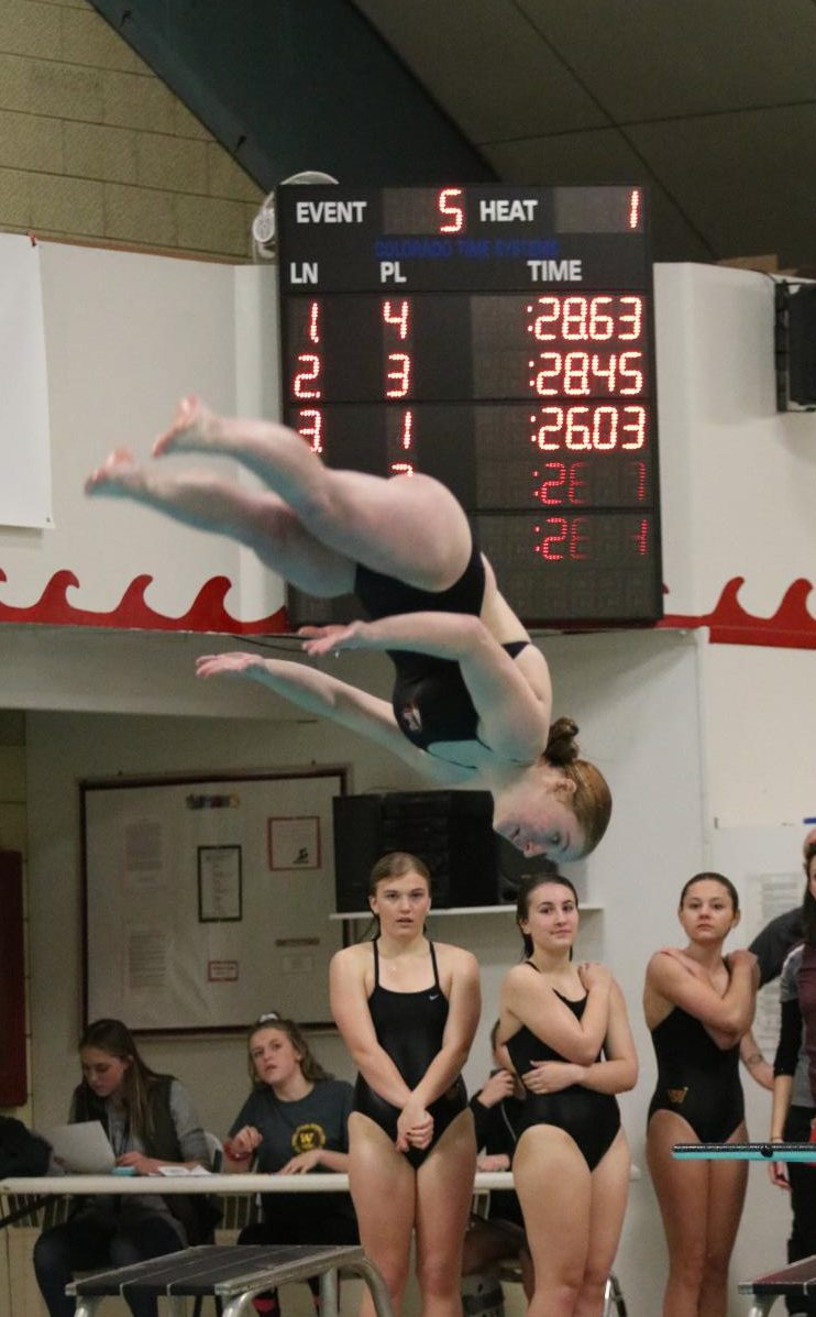 Eaton's Emily Anderson performs a flip in mid-air during the diving portion of the meet.