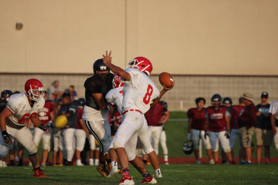 Quarterback Ty Garnhart (12) throws a touchdown pass.