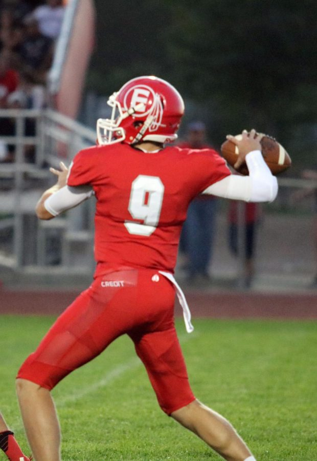 Quarterback Scott Grable (21) prepares to launch a pass to Gage Butler (21) during the game against Platte Valley on Sept. 15.