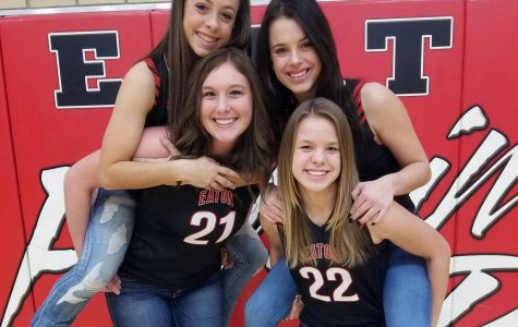 Seniors Sydney Booth and Michaela Hill hold Bailie Duncan and Gracie Schreiber on their backs.