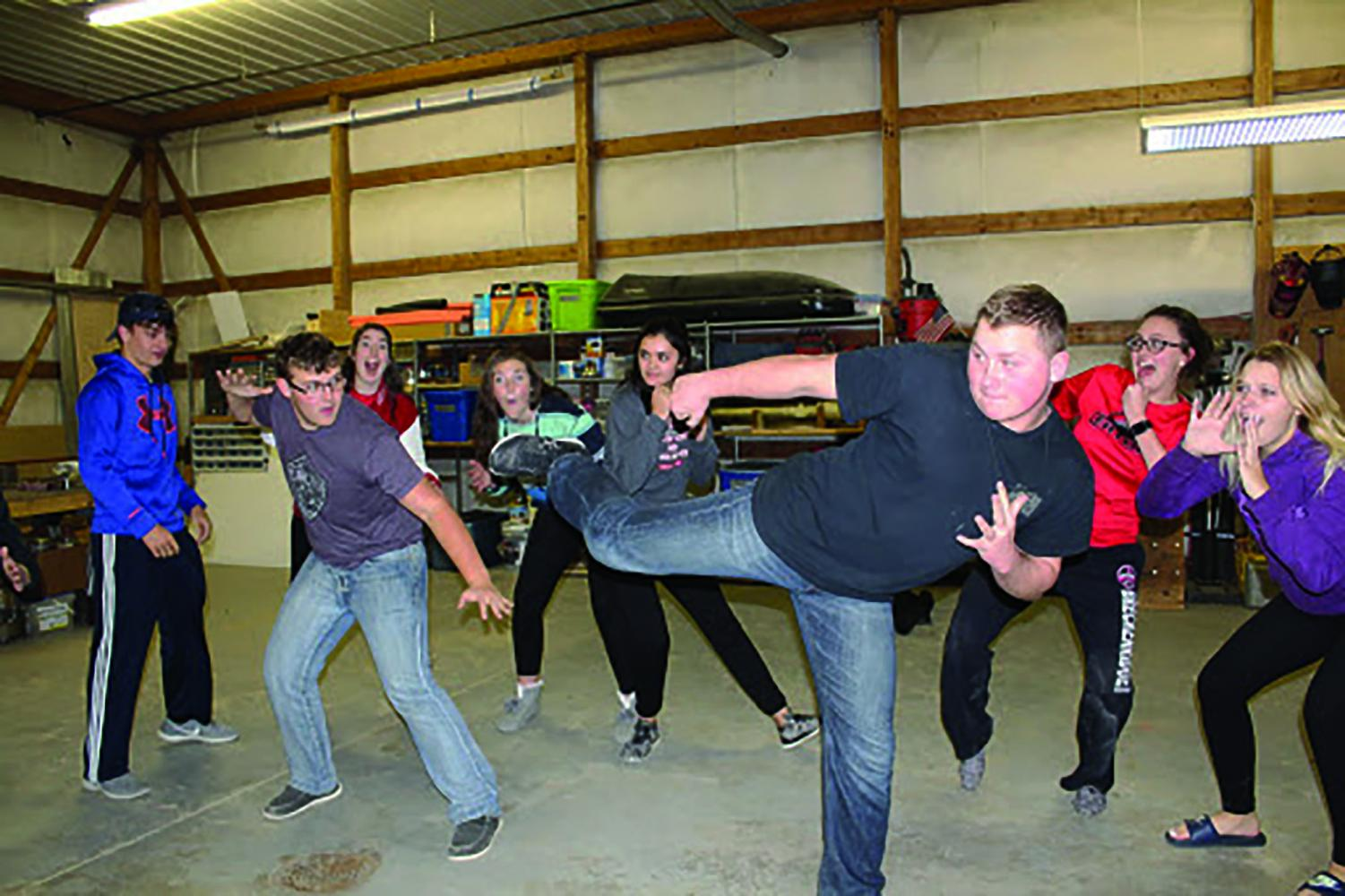 Production holds an impromptu rehearsal to practice lines and a fight scene.