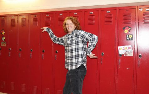 CJ Blaskowski (19) dances down the halls in his plaid black and white flannel, drawing the eye to his best accessory; his fiery red hair.