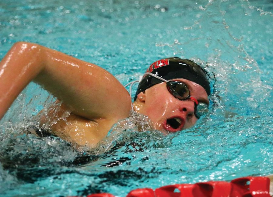 McKenna McGehee (19) swims in the 200 relay, where she helped her team secure second place.