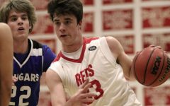 Reds remain optimistic despite loss to Resurrection High School