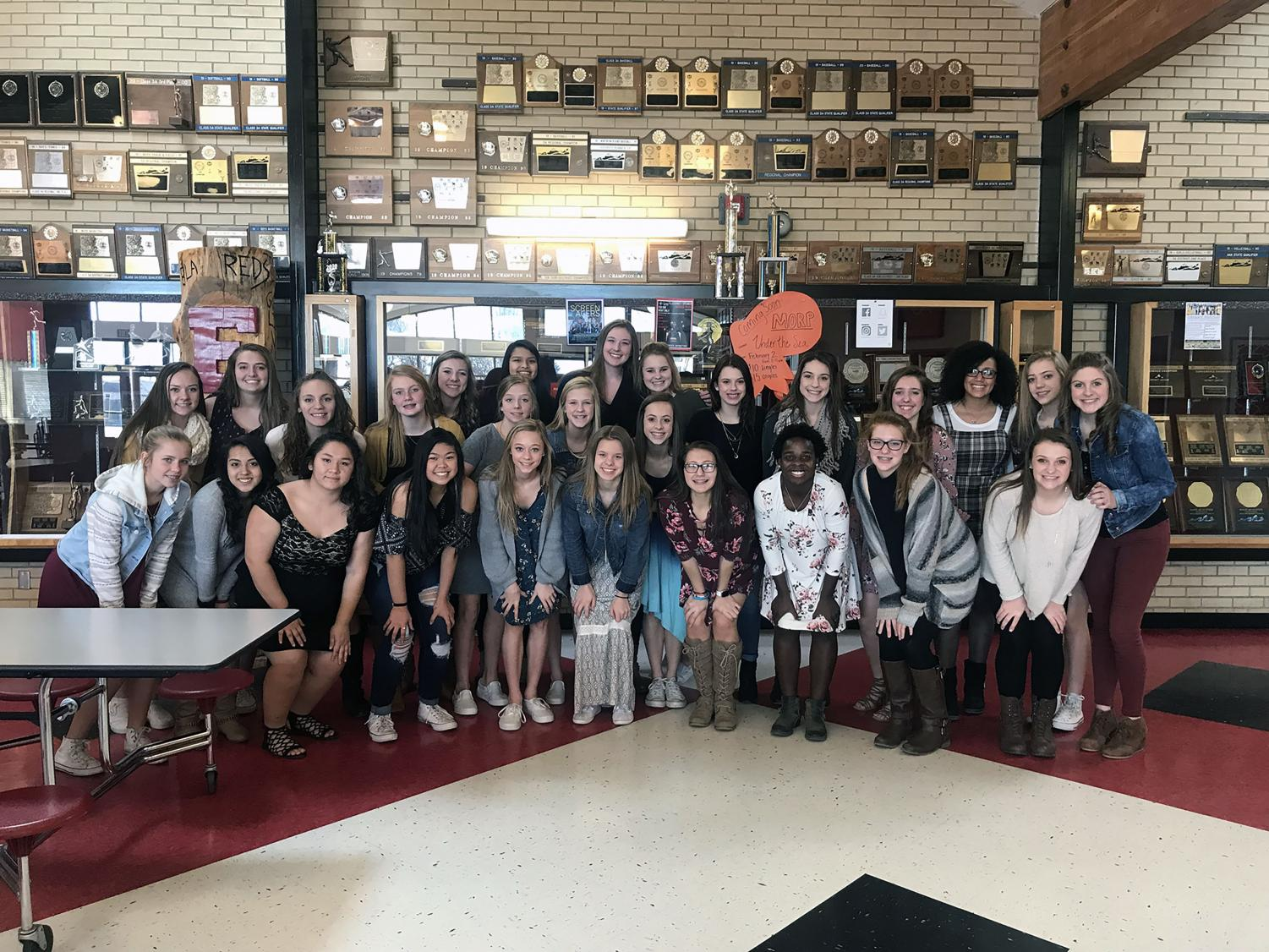 Girl's Basketball team members take a photo before heading to University.