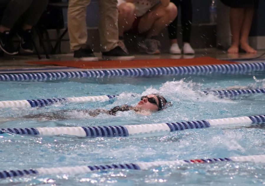Eaton's McKenna McGehee  swims backstroke in the 200 Individual Medley event.