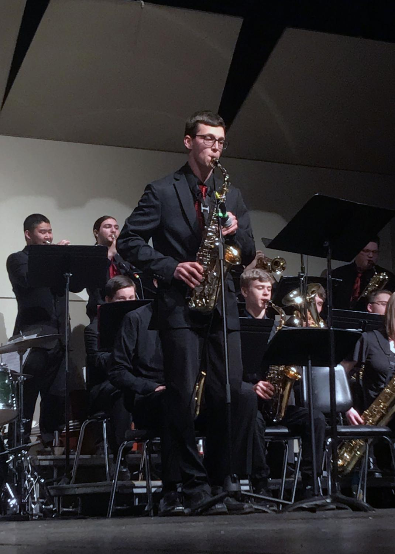 Ben Williams (21) alto saxophone solo during Jazz Combo performance