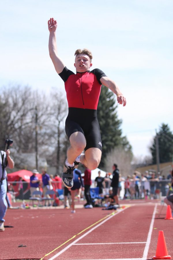 Scott Grable (21) jumps at home meet.