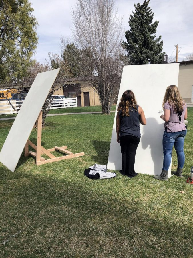 Jacqueline Alcala (19) and Rylie Book-Cass (19) work on mural for REDx