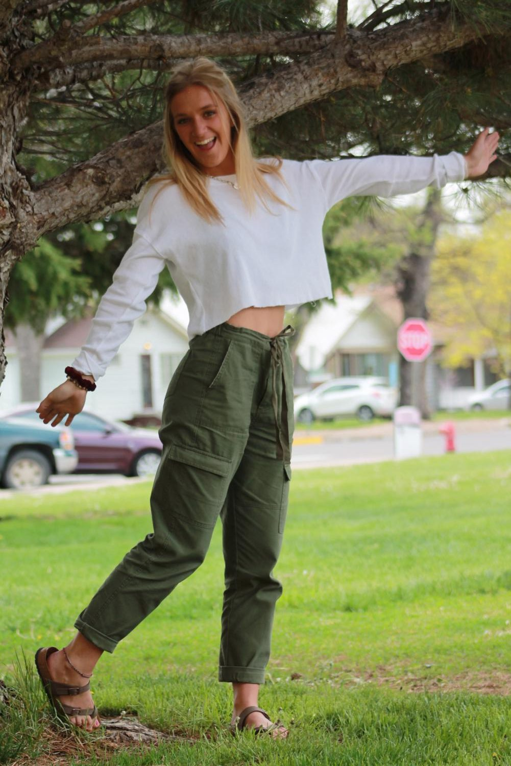 Matea Floryance (20) poses in her green cargo pants and white crop top.
