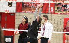Rylee Martin (22) sets ball for a kill in warm ups before Tuesday's game