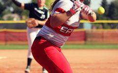 Jennifer Jarnigan (11) winds up to hit a ground ball.