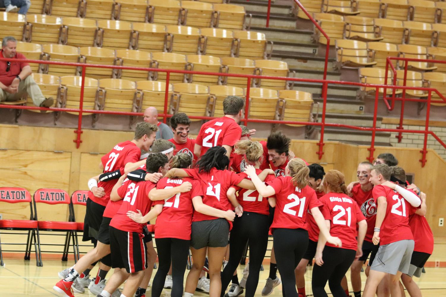 Junior boys get ready for powder puff volleyball game