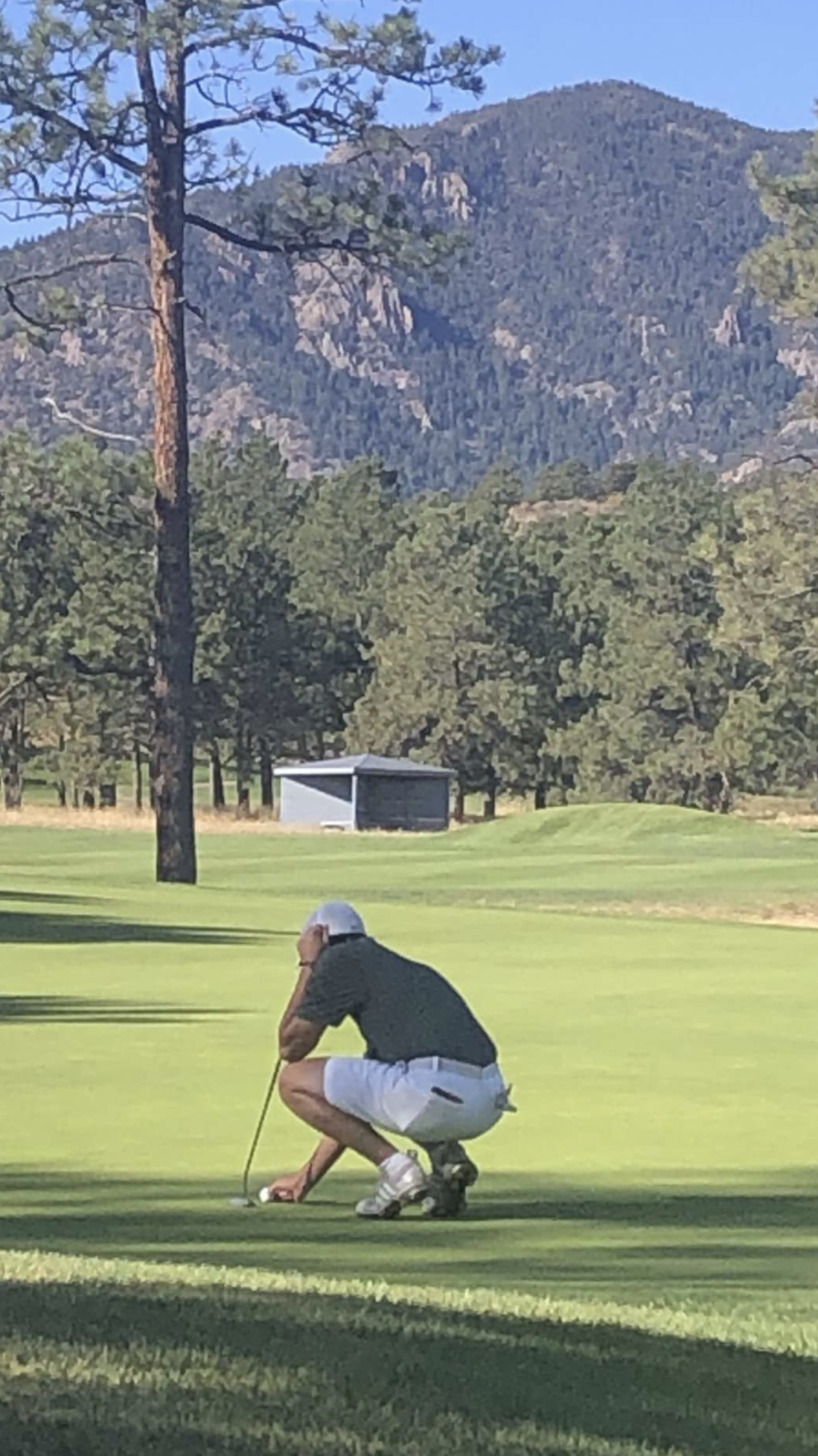 Bryce Leafgren (20) lines up for a putt at Eisenhower Blue at Air Force Academy