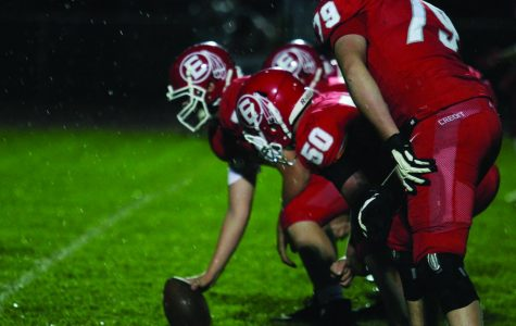 Reds gather win in homecoming game