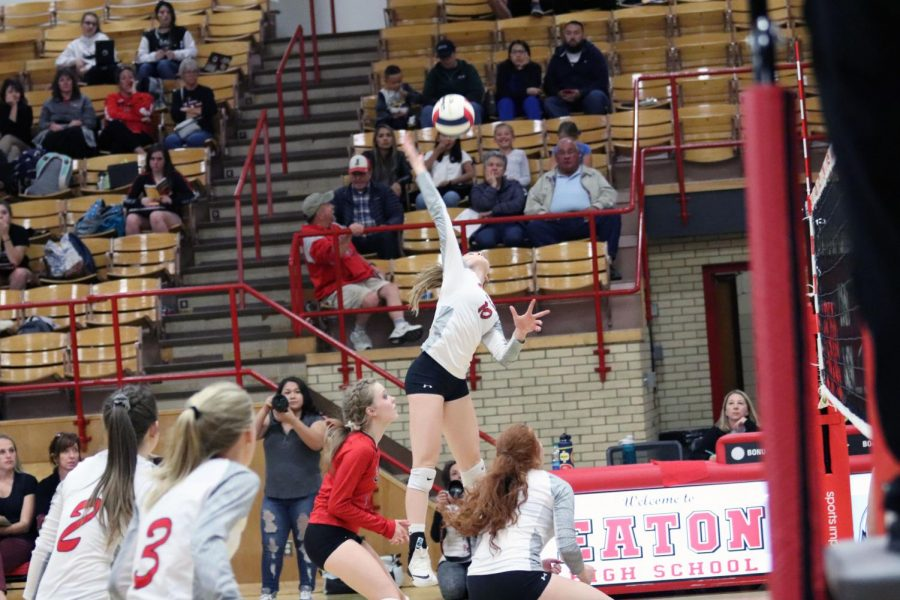 Sydney+Leffler+%2821%29+jumps+and+hits+the+ball+for+the+kill.+